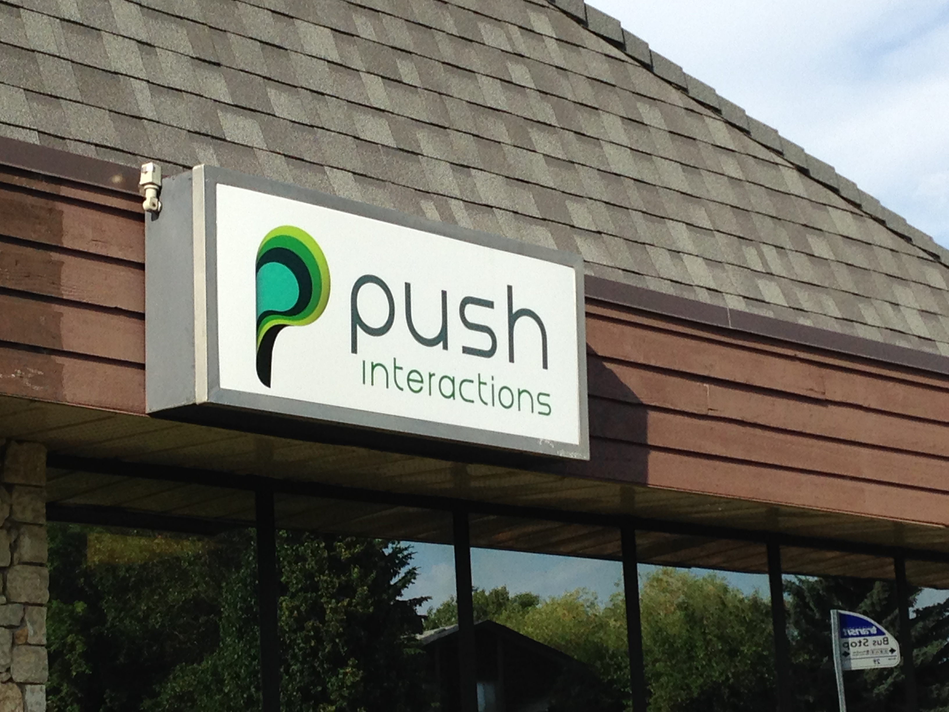 Our brand new sign on the outside of our building. Honk if you approve!