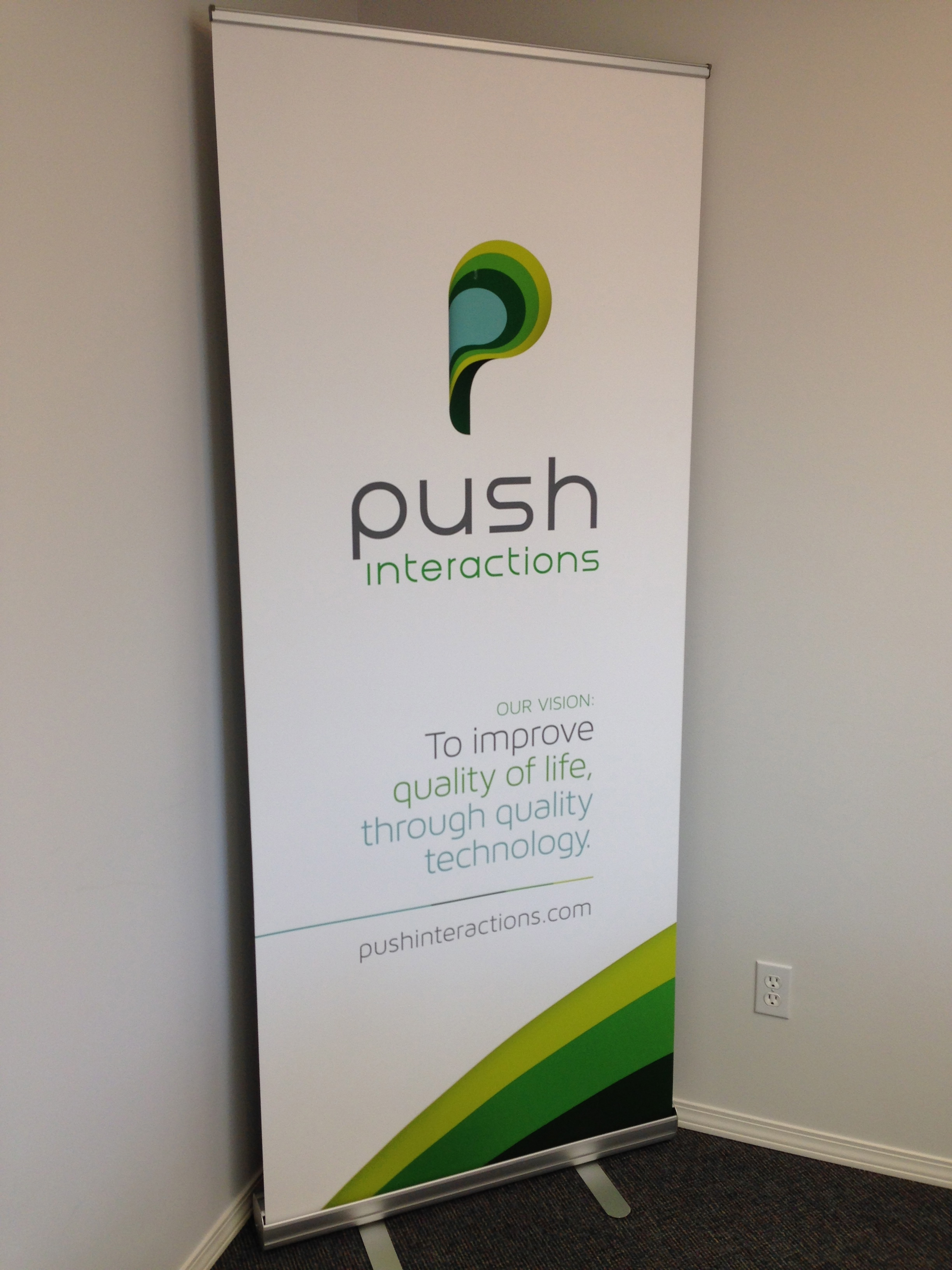 Our banner sign that sits proudly in our board room